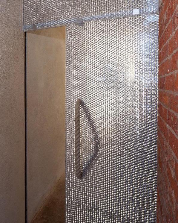 Zero Carbon House featuring Mykon door panels